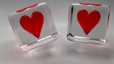 Red hearts in glass cubes